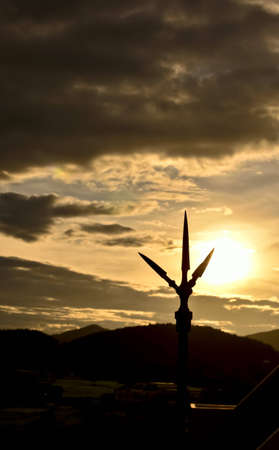 lightning rod silhouete at sunset photo