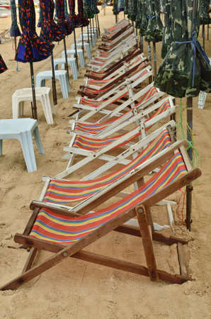 seat and umbrella on a beach photo