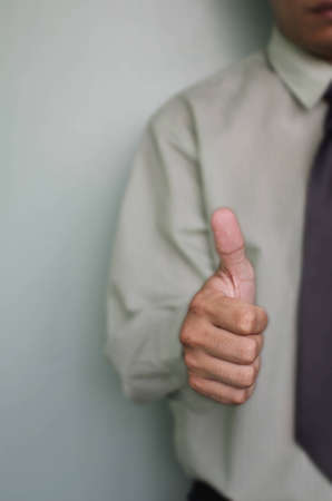 Business man shows thumb up  Stock Photo - 15284839