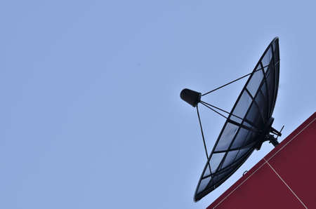 satellite dish againts blue sky