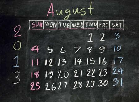 8 years old: calendar  august 2013  on a blackboard