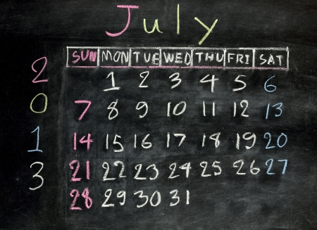 calendar july 2013 on a blackboard photo