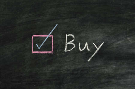 buy and button written on blackboard Stock Photo
