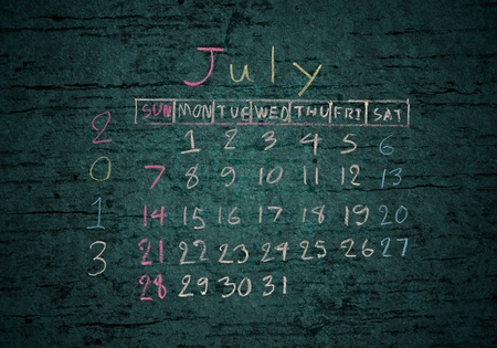 calendar 'July 2013' on grunge texture blackground photo