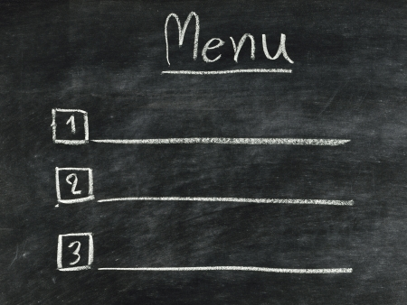 the word menu written in concept with chalk on blackboard Stockfoto