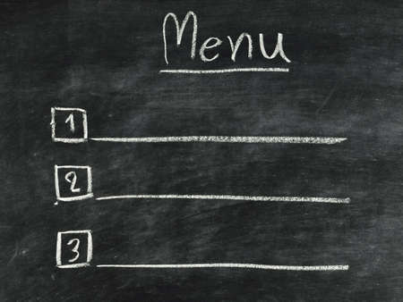 the word menu written in concept with chalk on blackboard Stock Photo