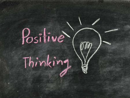 the word positive thinking and light bulb drawn on a chalk board,business concept Stock Photo - 16798353