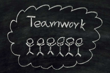 Teamwork concept written on blackboard photo