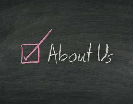 about us written on blackboard