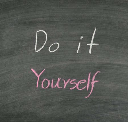 do it yourself written on blackboard