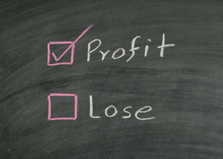 selecting profit on blackboard photo
