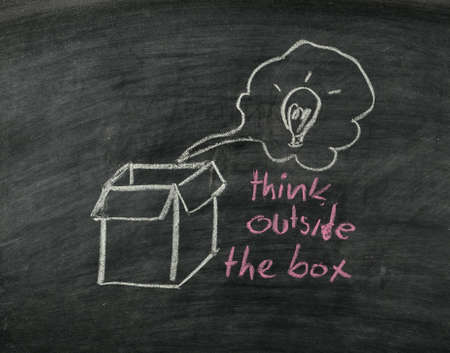 think outside the box concept on blackboard Stock Photo