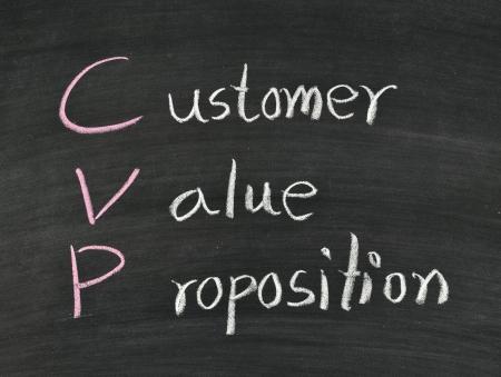 valor: cliente, el valor, la proposici�n escrito en la pizarra Foto de archivo