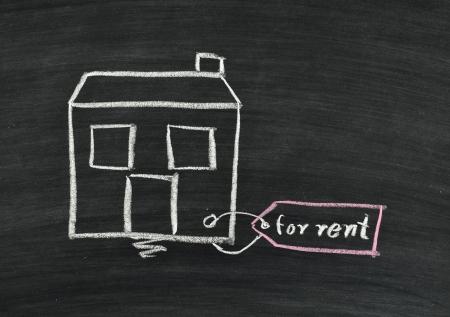 home for rent written on blackboard