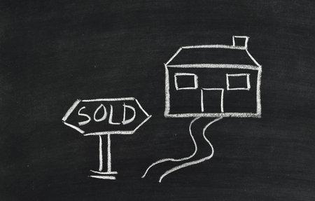 sold house written on blackboard photo