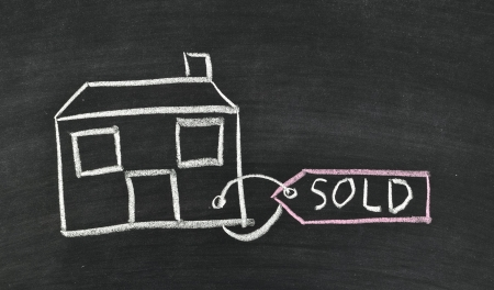 sold house written on blackboard photo