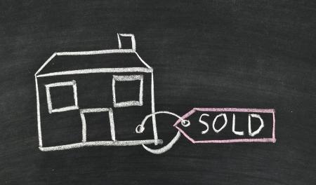 sold house written on blackboard