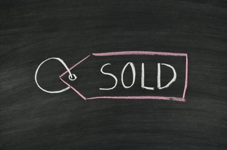 sold tag written on blackboard Stock Photo - 17376311
