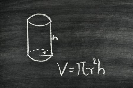 Cylindrical volume formula written on blackboard