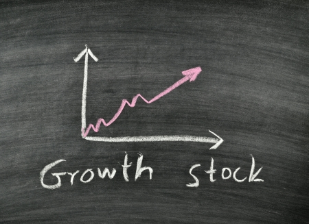 growth stock and business graph on blackboard Stock Photo - 17728532