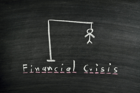 hangman and word financial crisis on blackboard Stock Photo - 17728516
