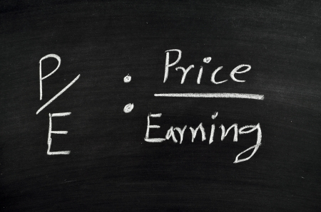 price per earning ratio written on blackboard