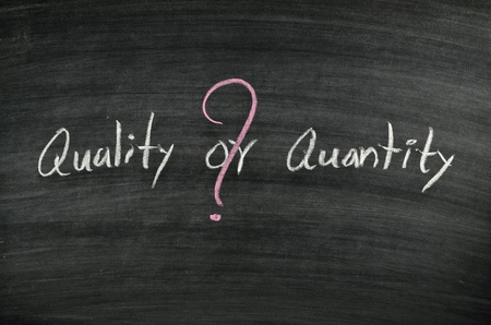 quality or quantity written on blackboard Stock Photo - 17728528