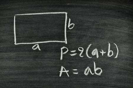 rectangular area and perimeter formula written on blackboard Stock Photo