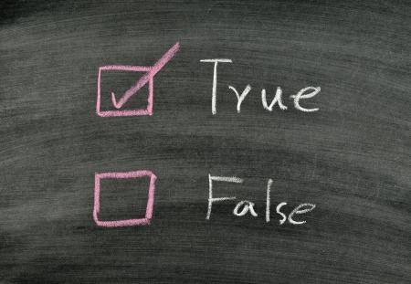 checking true on blackboard Stock Photo