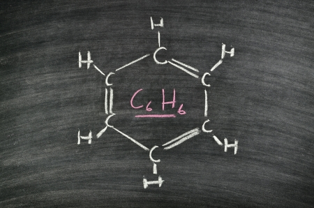 molecule structure of Benzene, aromatic hydrocarbon written on blackboard Stock Photo - 17932684
