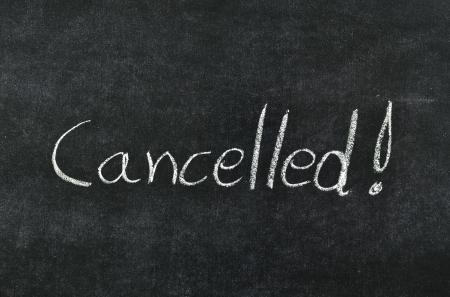 cancelled written with chalk on blackboard