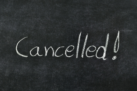 cancellation: cancelled written with chalk on blackboard