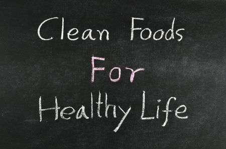clean foods for healthy life,healthy concept written on blackboard Stock Photo