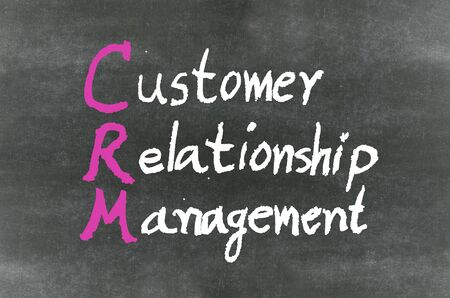 CRM handwritten with chalk on a blackboard photo