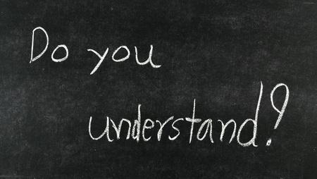 emigrant: do you understand? written on blackboard Stock Photo
