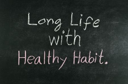 long life with healthy habit word written on blackboard Stock Photo
