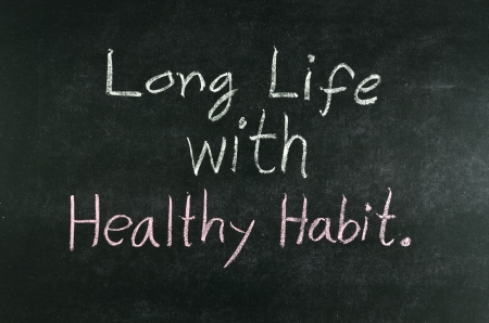 moderation: long life with healthy habit word written on blackboard Stock Photo