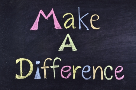 differences: word make a difference handwritten on blackboard