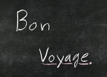 bon: Bon Voyage, written on a blackboard. Stock Photo