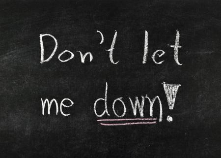 words Dont let me down! written on blackboard