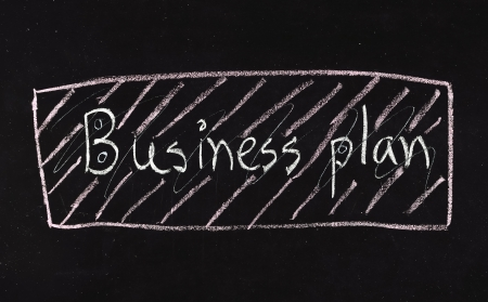 'BUSINESS plan' written on blackboard photo