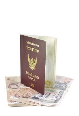 Thailand passport and banknote on white background. photo
