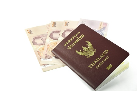 Thailand passport and banknote on white background  photo