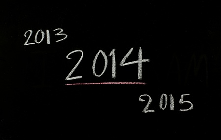 2014 written on blackboard Stock Photo