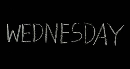 hand writing wednesday on blackboard