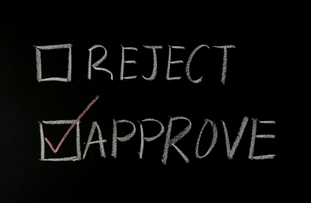 qualify: choosing approve with chalk on blackboard