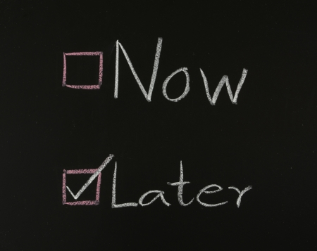 later: choosing later,concept writing on blackboard