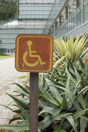 accessible: wooden accessible disabled parking sign  Stock Photo