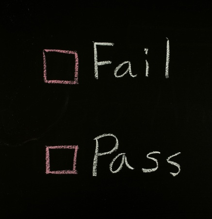select fail or pass written on blackboard  Stock Photo