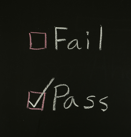 select pass written on blackboard  Stock Photo